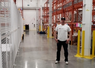 Ryan Elgert standing in Canadian Blood Services warehouse
