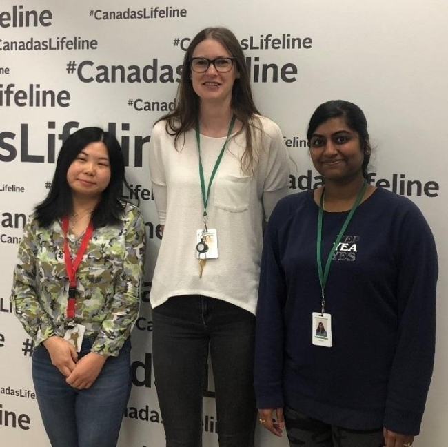 The three authors of this blog post stand in a donor centre in Calgary